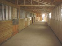 24 x 75 American Barn with the walkway in front of the stables.