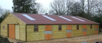 36 x 60 American Barn with 5 - 12 x 12 units on each side. Featuring a red Onduline Roof.