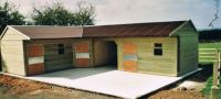 2 - 14 x 12 stables, standard corner unit and an 8 x 12 hay store, with a red onduline roof.