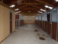 Internal view showing Windsor range fronts. Tack rooms lined with vertical T&G boarding.